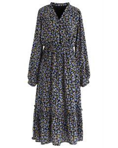 Robe portefeuille bleue à ourlet volanté
