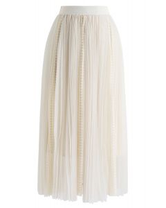 Jupe mi-longue plissée en dentelle exquise en crème