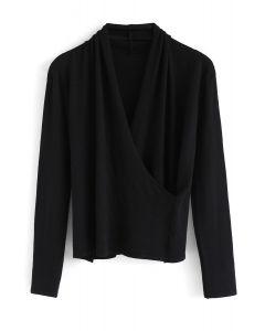 Enveloppez l'instant du haut en tricot noir